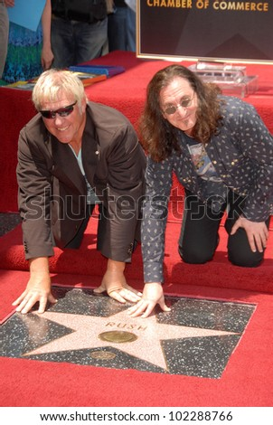Alex Lifeson and Geddy Lee at the induction ceremony for RUSH into the Hollywood Walk of Fame, Hollywood, CA. 06-25-10