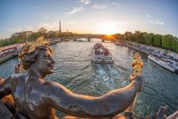Alexandre III bridge in Paris against Eiffel Tower with boat on Seine, France