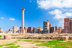 Alexandria, Egypt. Cityscape with Pompeys Pillar. This Roman triumphal column was built in 297 AD