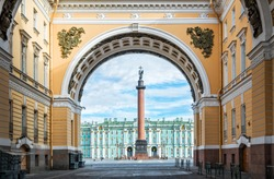 Alexandrian column with an angel on the Palace Square in St. Petersburg. View through the arch of the General Staff.
