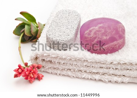 algae soap on white towel and one flower