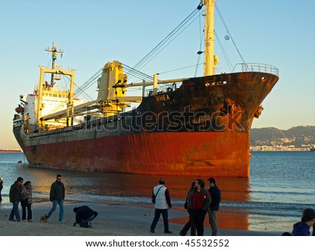 ALGECIRAS, SPAIN - JANUARY 29: Cargo ship got stuck on the beach of Algeciras, in Algeciras, Andalusia, Spain, January 29, 2010. Ship accidents happen often when the weather is stormy.
