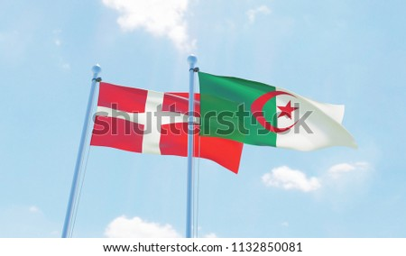 Algeria and Denmark, two flags waving against blue sky. 3d image #1132850081