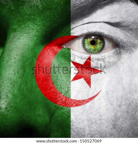 Algerian flag painted on a man's face to support his country Algeria