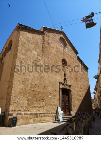 Alghero, Sardinia, Italy - June 26, 2019 street view of the historical old town  on summer day #1445310989