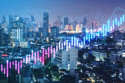 Algorithmic trading and financial concept with digital screen with growing forex chart graphs and circuit on night city background. Double exposure