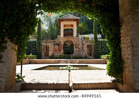 Alhambra de Granada. Pavilion and pond in the gardens of El Partal Palace