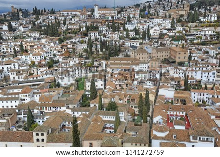 Alhambra Spain Granada Andalucia - View of the city - roofs of houses with travertine tiles #1341272759