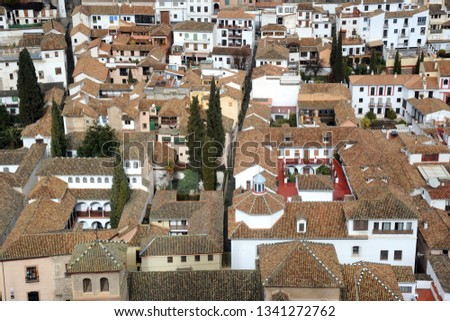 Alhambra Spain Granada Andalucia - View of the city - roofs of houses with travertine tiles #1341272762