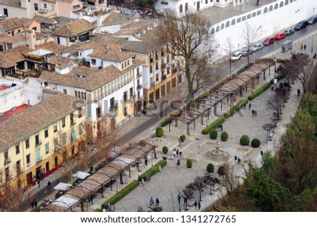 Alhambra Spain Granada Andalucia - View of the city - roofs of houses with travertine tiles #1341272765