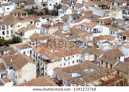 Alhambra Spain Granada Andalucia - View of the city - roofs of houses with travertine tiles #1341272768
