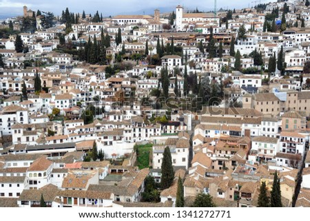 Alhambra Spain Granada Andalucia - View of the city - roofs of houses with travertine tiles #1341272771