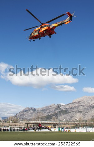 ALICANTE COAST, SPAIN - FEBRUARY 15. Search and rescue maneuvers by the Spanish army helicopter at a conference of Emergency and Public Safety in Altea, Spain, on February 15, 2015
