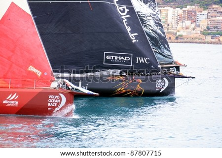 "ALICANTE, SPAIN - OCTOBER 29: Scoring first race of the ""Volvo Ocean Race 2011-2012"" in the bay of Alicante. With the Camper, Abu Dhabi and Puma Team starting race on october 29, 2011 in Alicante."