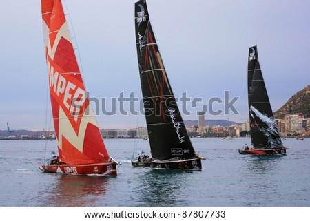 "ALICANTE, SPAIN - OCTOBER 29: Scoring first race of the ""Volvo Ocean Race 2011-2012"" in the bay of Alicante. With the Camper, Abu Dhabi and Puma Team sailing on october 29, 2011 in Alicante."