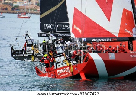 "ALICANTE, SPAIN - OCTOBER 29: Scoring first race of the ""Volvo Ocean Race 2011-2012"" in the waters of the bay of Alicante. With the Camper and Abu Dhabi Team sailing on october 29, 2011 in Alicante."