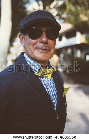 ALICANTE, SPAIN - SEPTEMBER 25, 2016: Close up of a middle aged man dressed in dapper styles is looking at the camera on the Distinguished Gentleman's Ride day, a global fundraiser for prostate cancer
