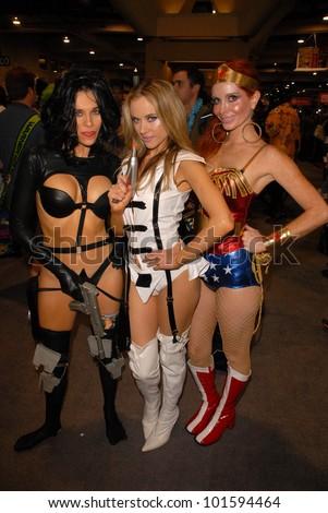 Alicia Arden as Aeon Flux, Paula Labaredas as Barbarella and Phoebe Price as Wonder Woman at San Diego Comic Con, San Diego Convention Center, San Diego, CA. 07-24-10
