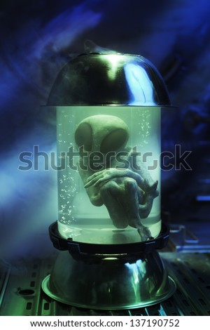 alien in a test tube with dramatic lighting
