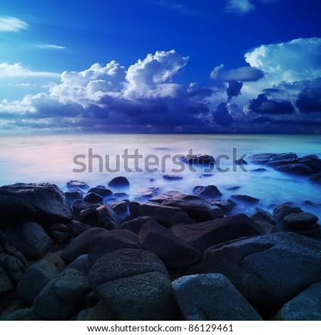 Alien sea at dawn, a long exposure fantasy - stock photo