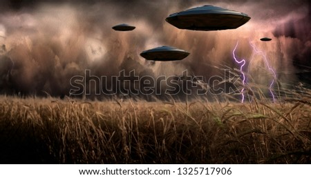 Aliens Invade. UFOs flies over the field of wheat. Flying saucers in stormy sky. 3D rendering