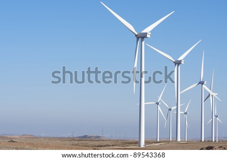 aligned windmills for renowable electric production with clear sky