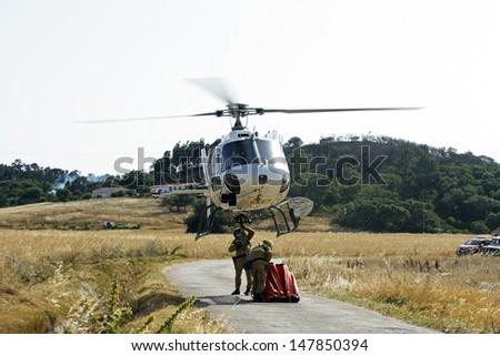 ALJEZUR - JULY 6: Firefighters fighting a huge bushfire in the national park near Aljezur on 6th july 2013 in Portugal