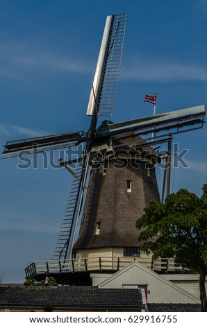 "ALKMAAR, THE NETHERLANDS - AUGUST 25, 2013: ""´Roode Hert"" windmill in Alkmaar, the Netherlands, built in 1925, being used for grinding grain."