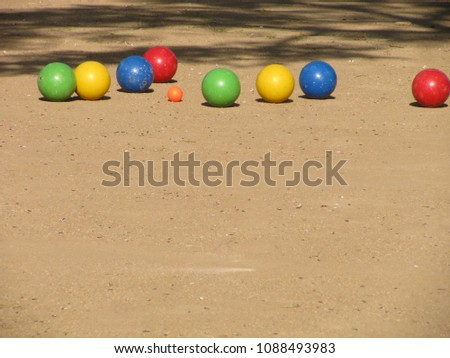All bocce balls have been played and sit on the court in the Italian version of the international bowling game.