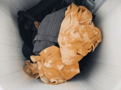 All clothes used in a week are in the washing machine and ready to be cleaned. But before washing it is a good idea to separate colored clothes that easily fade and whites.