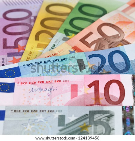 All current Euro banknotes forming a money background
