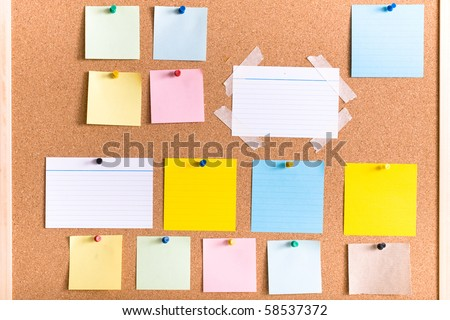 all different types of notes on cork board, blank, stripped, attached with pin and tape