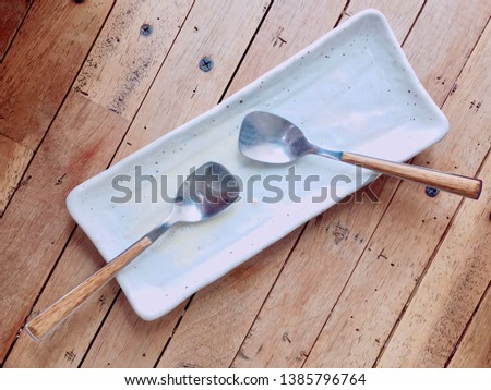 All dishes, Dishes with a spoon and fork when dining out, empty dish on the wooden table in restaurant