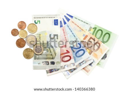 All european currency coins and bills from 5 to 100 Euros - including new 5 euro bill - fanned out on white background