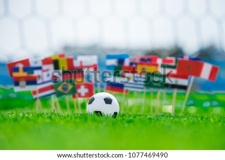 All Flags of Football. Football net in background. Flags on football pitch, tournament photo. Fans, support concept photo