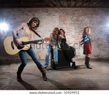 All girl band practicing before a big performance - stock photo