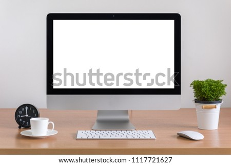 All in one computer, mouse, keyboard, coffee cup and plant vase  on wooden table #1117721627