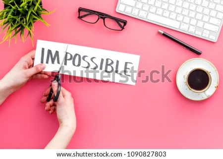 All is possible concept. Cutting the part im of written word impossible by sciccors. Pink background top view copy space #1090827803