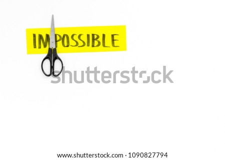 All is possible concept. Cutting the part im of written word impossible by sciccors. White background top view copy space #1090827794