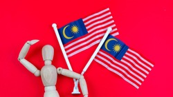 All Malaysian celebrating independence day on 31st August and Malaysia day on 16th September each year. A celebration on Malaysia historical day. Selective focus on the Malaysia flag.