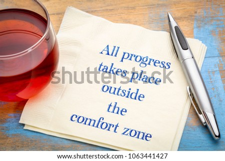 All progress takes place outside the comfort zone - inspiraitonal handwriting on a napkin with a cup of tea Сток-фото ©