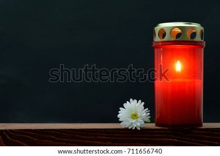 All Saints Day burning candle
