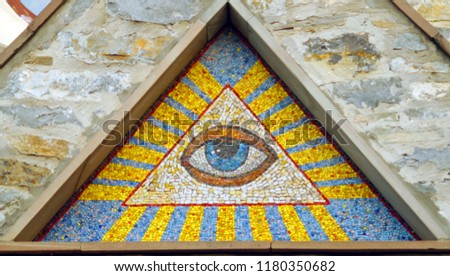 All-seeing eye of God - a mosaic of wall background medieval church. Eye of Providence - famous symbol of Masons and Illuminati.
