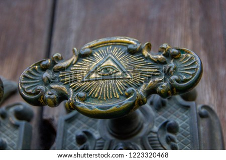 All seeing eye of illuminati on a door knob of the Illuminati freemason in Stockholm, Sweden.