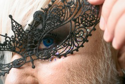 All the freaky people make the beauty of the world. Fetish fashion. Transgender man wear lace mask. BDSM fashion accessory. Heterosexual man with male makeup. Glamorous trashy look.