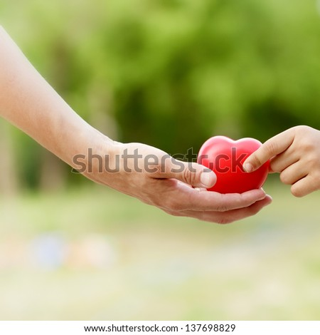 All the love given to child - love (heart) in hand