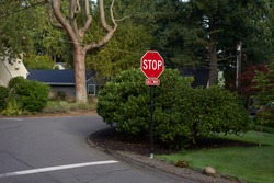 All-way stop (also known as four-way stop) sign on a quiet neighborhood street, a low traffic-volume location.