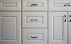 All white kitchen cabinets and drawers.