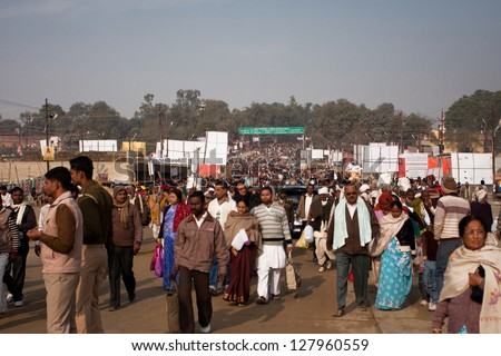 ALLAHABAD, INDIA - JANUARY 27: People movement on the way to holy Sangam during the biggest festival in the world - Kumbh Mela on January 27 2013 in Allahabad, India