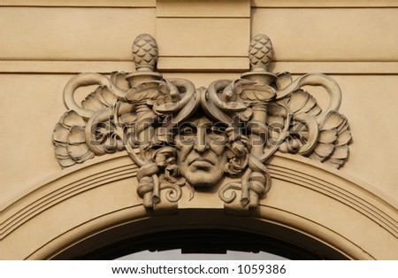 Allegory of trade, a stucco mask on the facade of the Municipal House in Prague, Czech Republic